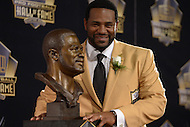 Canton, Ohio - August 8, 2015: Former NFL player Jerome Bettis poses with his bust during the 2015 Pro Football Hall of Fame enshrinement in Canton, Ohio, August 8, 2015.  (Photo by Don Baxter/Media Images International)
