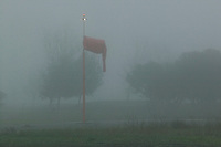 The wind sock hangs limp during a foggy morning at the Petaluma Municipal Airport, Petaluma, Sonoma County, California