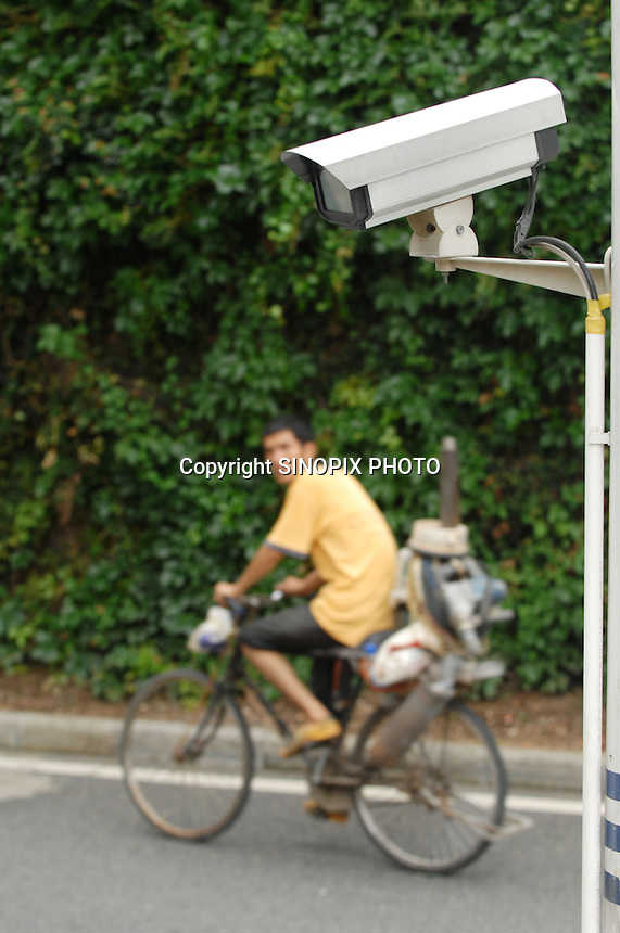 CCTV cameras monitor citizens in China's southern city of  Shenzhen.  shenzhen is the tsting gound for an new all encompassing surveillance system known as Golden Shield.<br />