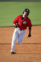 Eddy Alvarez (1) of the Kannapolis Intimidators hustles towards third base against the Hickory Crawdads at CMC-Northeast Stadium on May 21, 2015 in Kannapolis, North Carolina.  The Intimidators defeated the Crawdads 2-0 in game one of a double-header.  (Brian Westerholt/Four Seam Images)