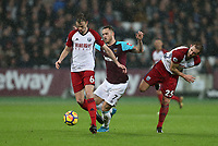West Ham United's Marko Arnautovic gets in between West Bromwich Albion's Jonny Evans and Craig Dawson<br /> <br /> Photographer Rob Newell/CameraSport<br /> <br /> The Premier League - West Ham United v West Bromwich Albion - Tuesday 2nd January 2018 - London Stadium - London<br /> <br /> World Copyright &copy; 2018 CameraSport. All rights reserved. 43 Linden Ave. Countesthorpe. Leicester. England. LE8 5PG - Tel: +44 (0) 116 277 4147 - admin@camerasport.com - www.camerasport.com