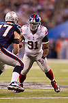 New York Giants defensive lineman Jason Peirre-Paul (90) battles against New England Patriots offensive lineman Nate Solder (77) during the NFL Super Bowl XLVI football game on Sunday, Feb. 5, 2012, in Indianapolis. The Giants won 21-17 (AP Photo/David Stluka)...