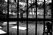 Wroclaw 14.04.2006 Poland..The worst and the most dangerous district in Wroclaw ( Poland ) , called by people &quot;The Bermuda Triangle&quot;. There are walls bearing an inscription &quot;Who will enter here, will not exit alive&quot; Many families there are pathological and live in extreme poverty. Children have no place for any games so they loaf around on this wasted district and disseminate a juvenile delinquency. Many of them become sexually active though thery are only 10-12 years old<br /> (Photo by Adam Lach / Napo Images)<br /> <br /> Najbardziej nabezpieczna dzielnica we Wroclawiu zwana przez ludzi Trojkatem Bermudzkim. Sa tam sciany opatrzone napisem &quot; Kto tu wejdzie, nigdy nie wyjdzie stad zywy&quot; Mieszka tam wiele rodzin patologicznych i zyja w wielkiej nedzy. Dzieci wlocza sie po ulicach nie majac miejsc na zabawe i szerza przestepczosc wsrod nieletnich. Wiele z dzieci uprawia seks choc maja zaledwie 10-12 lat<br /> (Fot Adam Lach / Napo Images)
