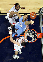 North Carolina Tar Heels guard Kendall Marshall (5) looks for the rebound next to Virginia Cavaliers guard Jontel Evans (1) and Virginia Cavaliers guard Joe Harris (12) during the game in Charlottesville, Va. North Carolina defeated Virginia 54-51.