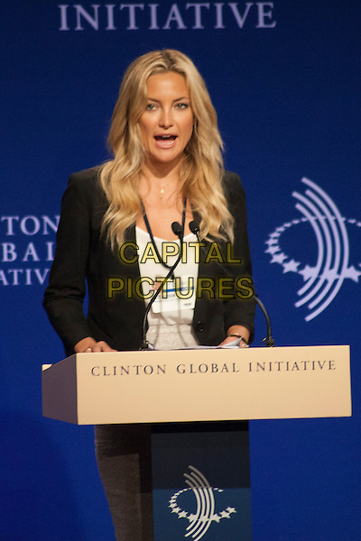 Kate Hudson <br /> 'Lessons from the Front Lines of Women's Leadership' during the 2013 Clinton Global Initiative (CGI), New York City, New York, USA.<br /> September 25th, 2013<br /> half length black blazer white top podium speech mouth open<br /> CAP/MPC/COR<br /> &copy;Corredor99/ MediaPunch/Capital Pictures