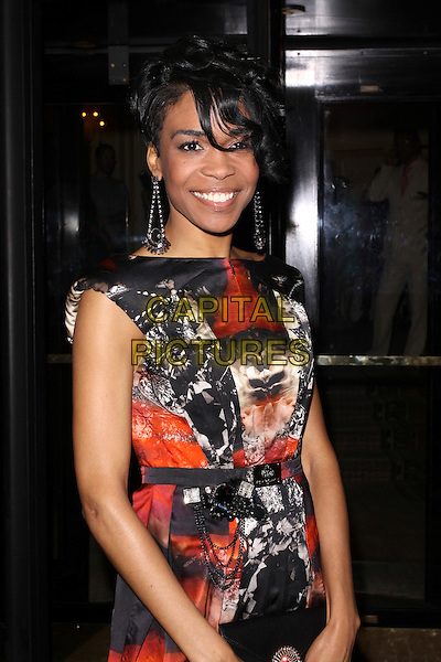 MICHELLE WILLIAMS (Ex Destiny's Child).The Ndoro Children's Charities fundraising gala at The Dorchester Hotel, London, England. .September 17th, 2009 .half length red black white print dress sleeveless dangling silver earrings .CAP/AH.©Adam Houghton/Capital Pictures.