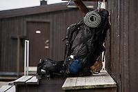 Backpack rests on bench outside STF Sälka mountain hut, Kungsleden trail, Lapland, Sweden