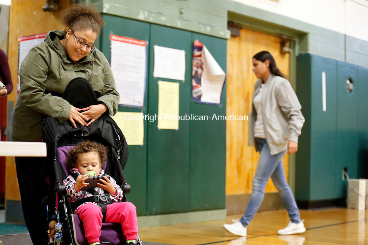 Waterbury, CT- 08 November 2016-110816CM04- Crystal Cruz and her daughter, Harley Santiago, 1 of Waterbury, wait for family after voting at Blessed Sacrament School on Tuesday.   Christopher Massa Republican-American