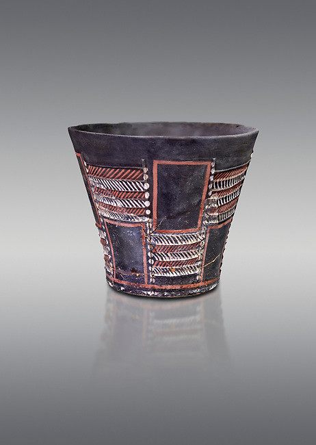 Minoan Kamares Ware sup with bold geometric polychrome decorations , Phaistos 1900-1700 BC; Heraklion Archaeological  Museum, grey background.<br /> <br /> This style of pottery is named afetr Kamares cave where this style of pottery was first found
