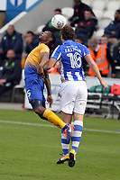 Tom Eastman of Colchester United challenges Krystian Pearce of Mansfield Town for the aerial ball during Colchester United vs Mansfield Town, Sky Bet EFL League 2 Football at the Weston Homes Community Stadium on 7th October 2017