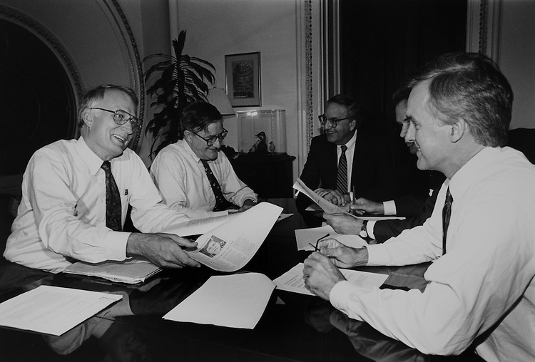 Bi-partisan group of Senators meeting to talk about health care in Mitchell's office. Left to right: Sen. David Durenberger, R-Minn., Sen. Lincoln Chafee, D-R.I., Sen. George Mitchell, D-Maine, Sen. John Breaux, D-La., Sen. Bob Kerrey, D-Nebr on September, 1994. (Photo by Laura Patterson/CQ Roll Call)