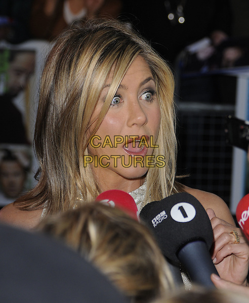 JENNIFER ANISTON.Horrible Bosses UK Premiere, BFI, London, England..20th July 2011.headshot portrait looks shocked surprised funny mouth open.CAP/CAN.©Can Nguyen/Capital Pictures.