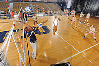 11 September 2011:  FIU's team runs through drills prior to the match.  The FIU Golden Panthers defeated the Florida A&M University Rattlers, 3-0 (25-10, 25-23, 26-24), at U.S Century Bank Arena in Miami, Florida.