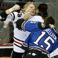 San Antonio Rampage's Eric Selleck, right, and Rockford Icehogs' Rob Flick fight during the second period of an AHL hockey game, Saturday, Jan. 14, 2012, in San Antonio. (Darren Abate/pressphotointl.com)