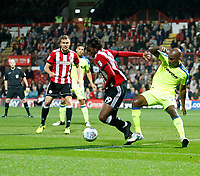Romaine Sawyers of Brentford fends off Andre Wisdom of Derby County during the Sky Bet Championship match between Brentford and Derby County at Griffin Park, London, England on 26 September 2017. Photo by Carlton Myrie / PRiME Media Images.