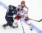 Corey Ronan (UConn - 11), Brandon Hickey (BU - 4) - The Boston University Terriers defeated the visiting University of Connecticut Huskies 4-2 (EN) on Saturday, October 24, 2015, at Agganis Arena in Boston, Massachusetts.
