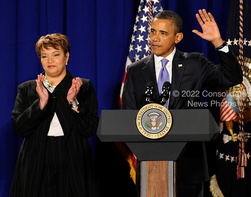 United States President Barack Obama waves after delivering thank you remarks to Environmental Protection Agency employees as EPA Administrator Lisa Jackson applauds, Tuesday, January 10, 2012, in Washington, DC.  .Credit: Mike Theiler / Pool via CNP