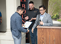 "Horacio Aceves, Academic Coordinator and Congressman Jimmy Gomez (CA-34) give a certificate of recognition to Giovanni Rubio.<br /> Upward Bound hosts their annual ""End of the Year"" celebration with participants and their families on May 12, 2018 in the courtyard of Booth Hall. Jimmy Gomez, U.S. Representative for California's 34th congressional district, was the featured speaker at the event.<br /> Upward Bound was established at Occidental College in 1966 and has since served over 2000 first generation, low income students in the Los Angeles region.<br /> (Photo by Marc Campos, Occidental College Photographer)"
