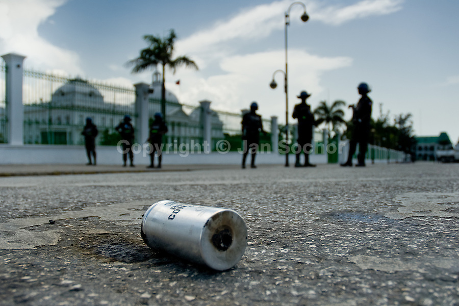 An empty tear gas cartridge seen in front of the Presidential Palace in the centre of Port-au-Prince, Haiti, 15 July 2008. The UN blue helmets from Nigeria guard the president René Préval. MINUSTAH (installed in Haiti by the UN in 2004) substitute the police therefore they are generally not welcomed by the Haitian population. The overall situation on Haiti gets worse every year and the extreme, hardly imaginable poverty hits more and more people. The Haitian economics is paralysed, there is no infrastructure, no food supplies, the population suffer from hunger, social and living conditions in Haitian slums (e.g. Cité Soleil) are a human tragedy. The rage grows and the tension continues with undiminished strength.