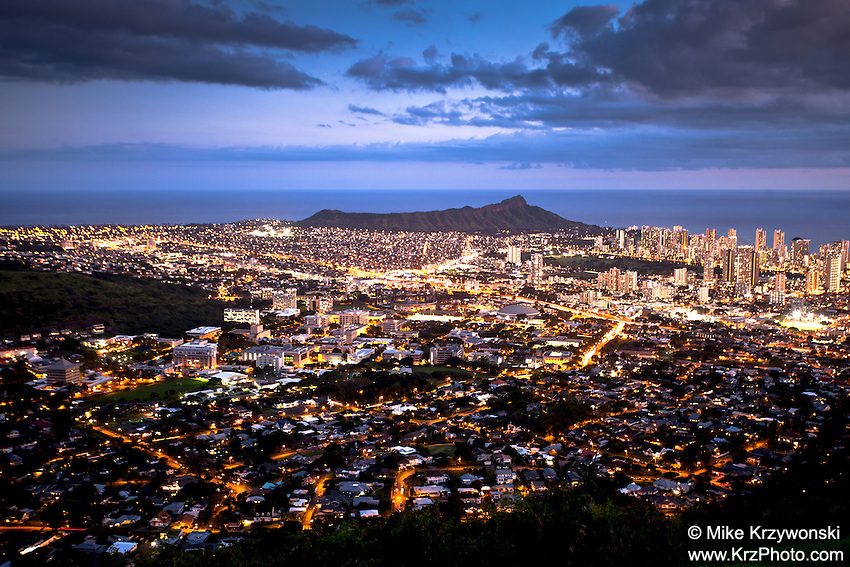 View of Honolulu city lights & Diamond Head Crater at night from the Tantalus Overlook, O'ahu
