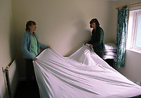 Pictured L-R: Christine Hughes and Jill Simpson prepare a double bed for the family of refugees in a house in Narberth, Wales, UK. Tuesday 11 July 2017<br /> Re: A family of Syrian refugees will be given accommodation in Narberth, Pembrokeshire, Wales, UK.