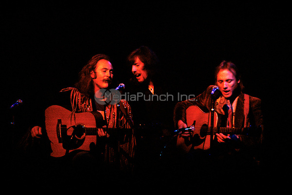 David Crosby, Graham Nash &amp; Steven Stills of Crosby, Stills, Nash &amp; Young performing on their '4 Way Street' tour at the Boston Garden in Boston, MA on May 29,  1970.<br /> &copy; Peter Tarnoff / MediaPunch