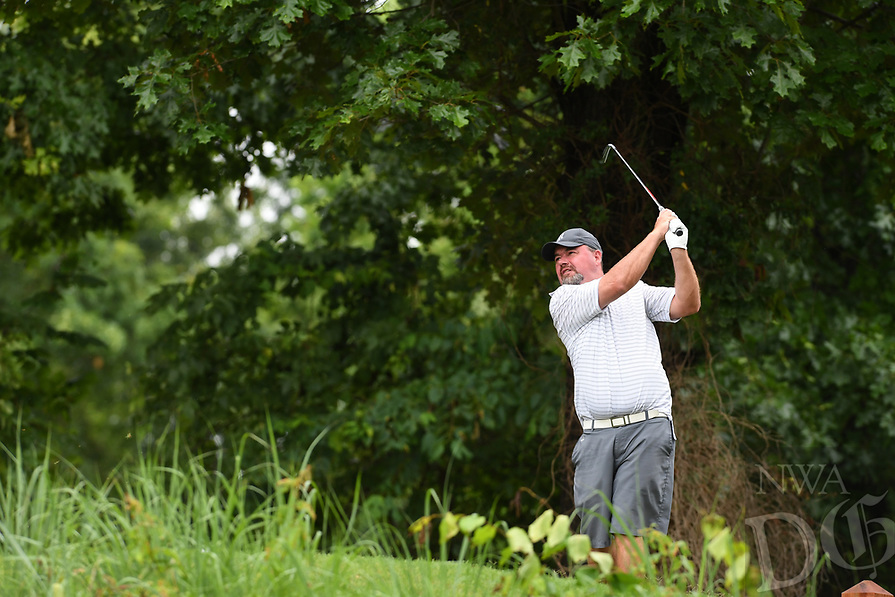 NWA Democrat-Gazette/J.T. WAMPLER Bryon Shumate watches his tee shot on hole 15 Sunday June 18, 2017 during the final round of the Chick-A-Tee golf tournament at Springdale Country Club.