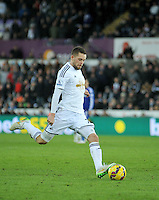 SWANSEA, WALES - JANUARY 17:   of  during the Barclays Premier League match between Swansea City and Chelsea at Liberty Stadium on January 17, 2015 in Swansea, Wales. Swansea's Gylfi Sigurdsson takes a free kick