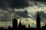 Silhouette of Houses of Parliament against dramatic evening sky London UK