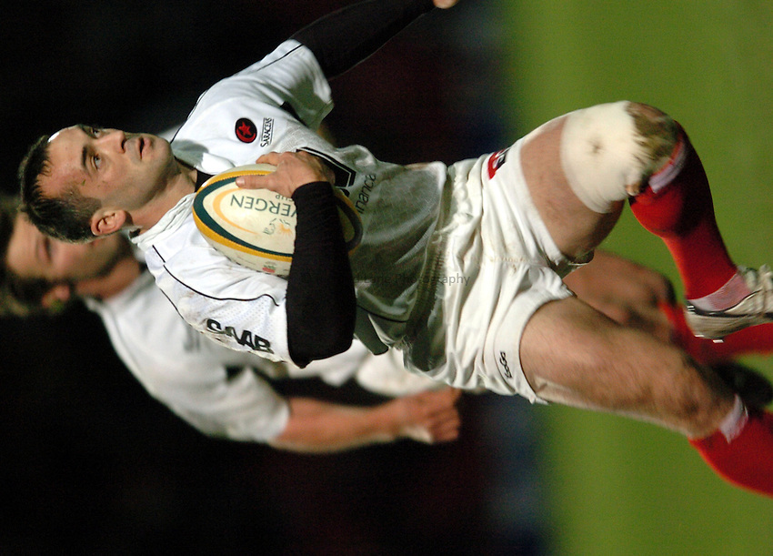 Photo. Henry Browne..19/12/2004..Saracens v Newcastle Falcons Powergen Cup...Thomas Castaignede runs with the ball..