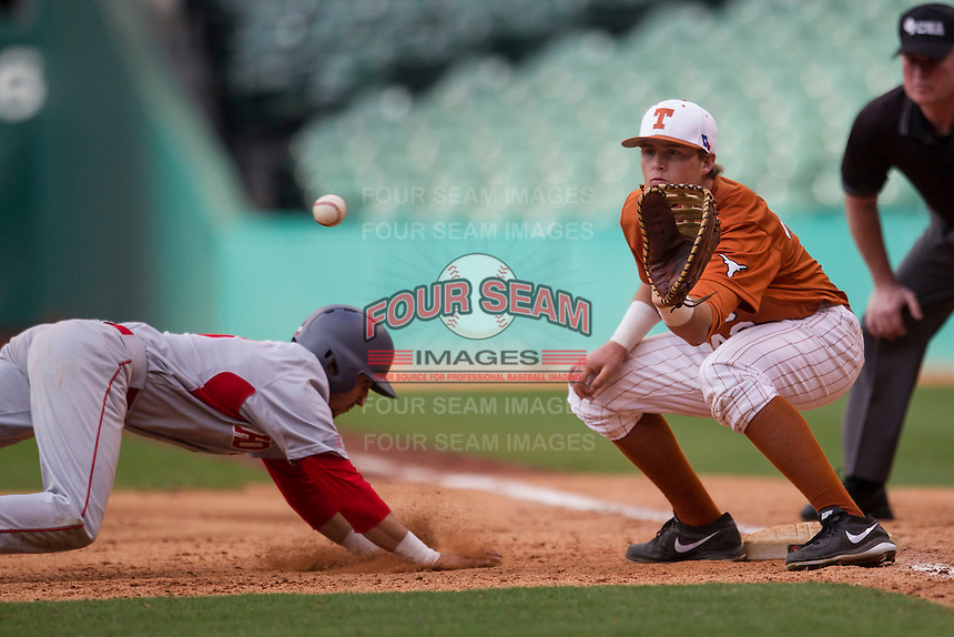 Texas Longhorns first baseman Kacy Clemens #42 catches a pickoff throw to first base during the NCAA baseball game against the Houston Cougars on March 1, 2014 during the Houston College Classic at Minute Maid Park in Houston, Texas. The Longhorns defeated the Cougars 3-2. (Andrew Woolley/Four Seam Images)