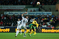 Thursday 24 October 2013  <br /> Pictured: Michu  of Swansea gives Djibril Cisse a shove in the back <br /> Re:UEFA Europa League, Swansea City FC vs Kuban Krasnodar,  at the Liberty Staduim Swansea