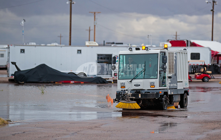 Feb 22, 2019; Chandler, AZ, USA; A sweeper works to clear puddles of water from the NHRA pits during a rain delay to qualifying for the Arizona Nationals at Wild Horse Pass Motorsports Park. Mandatory Credit: Mark J. Rebilas-USA TODAY Sports