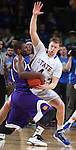 SIOUX FALLS, SD - MARCH 7: Garret Covington #31 of Western Illinois and Jake Bittle #4 of South Dakota State battle for the ball in the first half of the first round of the men's Summit League Championship Tournament game Saturday evening at the Denny Sanford Premier Center in Sioux Falls, SD.(Photo by Dick Carlson/Inertia)