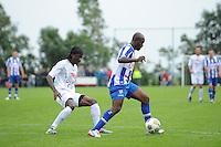 VOETBAL: OUDEGA (W): Sportpark It Joo, 17-07-2012, Oefenwedstrijd SC Heerenveen-Waasland Beveren (BEL), Alain Pierre Mendy (#17), Matthew Amoah (#14), ©foto Martin de Jong