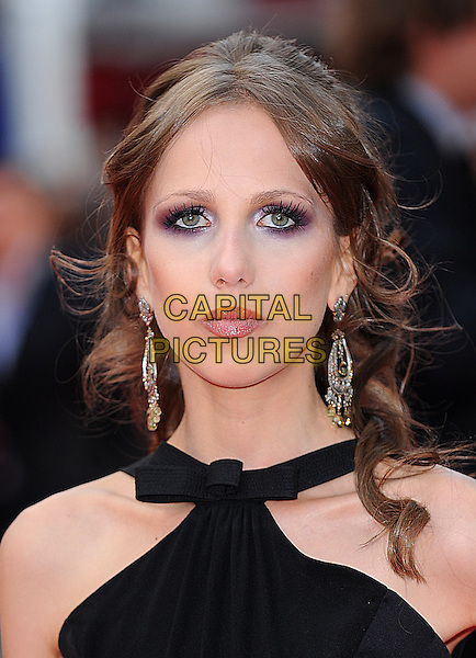 "ALLEGRA VERSACE.at ""The Dark Knight"" UK Film Premiere, Odeon Leicester Square, London, England, 21st July 2008..Batman movie black halterneck earrings make-up purple eyeshadow eyelashes .CAP/BEL.©Tom Belcher/Capital Pictures"