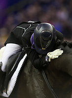 OMAHA, NEBRASKA - MAR 30: Maria Florencia Manfredi pats Bandurria Kacero after her ride in the FEI World Cup Dressage Final I at the CenturyLink Center on March 30, 2017 in Omaha, Nebraska. (Photo by Taylor Pence/Eclipse Sportswire/Getty Images)