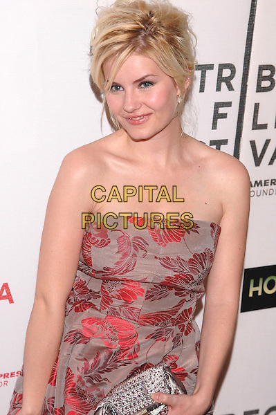 "ELISHA CUTHBERT.Premiere of his new film, ""House of Wax"", at the Stuyvesant High School,  part of the Tribeca Film Festival in downtown Manhattan. .April 30th, 2005.Photo Credit: Patti Ouderkirk/AdMedia.half length strapless red floral print dress silver jewel encrusted clutch purse bag.www.capitalpictures.com.sales@capitalpictures.com.© Capital Pictures."