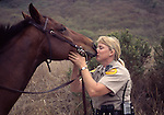 California State Park ranger with horse, Burleigh Murray State Park, Half Moon Bay