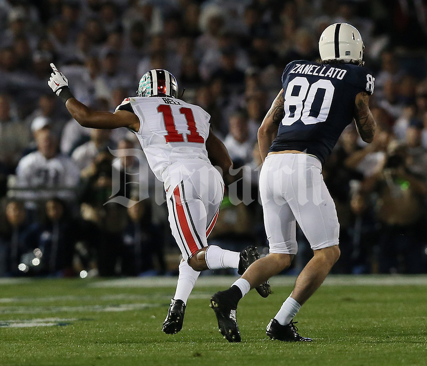 Ohio State Buckeyes defensive back Vonn Bell (11) celebrates his interception from Matt Zenellato (80) in the first quarter of their game at Beaver Stadium in State College, PA on October 25, 2014. (Columbus Dispatch photo by Brooke LaValley)