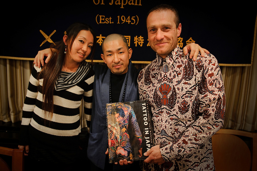 "[Left to Right] Writer Manami Okazaki, tattooist Horimyo and photographer Martin Hladik hold a copy of their book on Japanese tattoos. Tattoo demonstration, FCCJ, 25 Feb 2009. Author Manami Okazaki and Photographer Martin Hladik introduce their book: ""Tattoo in Japan"" while tattoo master Horimyo gives a demonstration of his art."