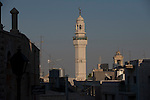 The minarets of a mosque, center, and the Church of Nativity, right, define the skyline of Bethlehem, West Bank.