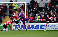 Lincoln City's Cian Bolger clears the ball under pressure from Grimsby Town's Ludvig Ohman<br /> <br /> Photographer Chris Vaughan/CameraSport<br /> <br /> The EFL Sky Bet League Two - Lincoln City v Grimsby Town - Saturday 19 January 2019 - Sincil Bank - Lincoln<br /> <br /> World Copyright © 2019 CameraSport. All rights reserved. 43 Linden Ave. Countesthorpe. Leicester. England. LE8 5PG - Tel: +44 (0) 116 277 4147 - admin@camerasport.com - www.camerasport.com