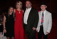 NWA Democrat-Gazette/CARIN SCHOPPMEYER Heaven Holland (from left), Traci and Adam Holland CAC Empowering Kids Award honoree, and Haden Holland attend Cherishing Children.