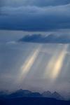 Monsoon storm over Capital Reef National Park near sunset creates spectacular light beams