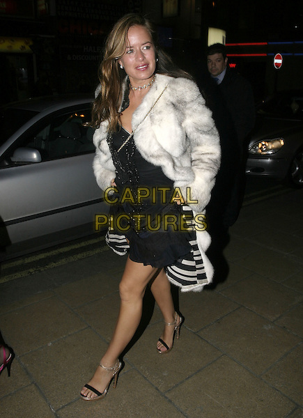 JADE JAGGER.Agent Provocateur - 10th Anniversary Party, Cafe de Paris, London, February 14th 2005..full length white grey fur car black dress.Ref: AH.www.capitalpictures.com.sales@capitalpictures.com.©Capital Pictures.