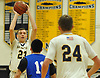 Kevin Voigt #23 of Massapequa, left, looks to pass to teammate John Ronan #24 during a Nassau County Conference AA-1 varsity boys basketball game against Hempstead at Massapequa High School on Wednesday, Jan. 17, 2018. Massapequa won by a score of 50-44.