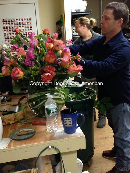 WOODBURY, CT - 13 Feb 2014 - 021314RH01 - Michelle Gorey, left, and Lou Williams, right, prepare flowers for Valentine's Day despite the snow at Petal Perfection & Confections in Woodbury. Rick Harrison Republican-American