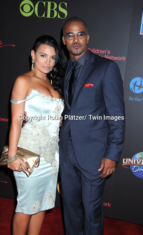 Shemar Moore and guest arriving at the 38th Annual Daytime Emmy Awards  on June 19, 2011 at The Las Vegas Hilton in Las Vegas Nevada. .photo by Robin Platzer/ Twin Images  ..212-935-0770