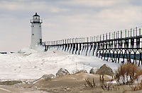Winter ice on Manistee North Pierhead Lighthouse. Manistee Michigan USA Lake Michigan.